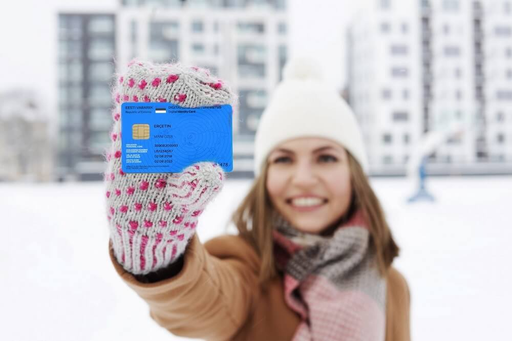 e-resident holding a card